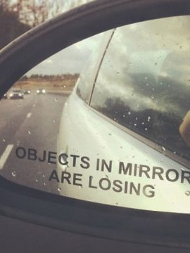 objects-in-mirror-are-losing-car-sticker